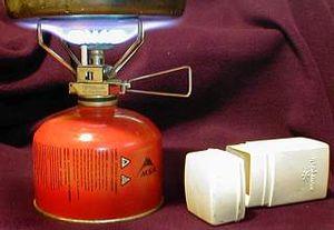 en: A small Snow Peak portable stove running o...