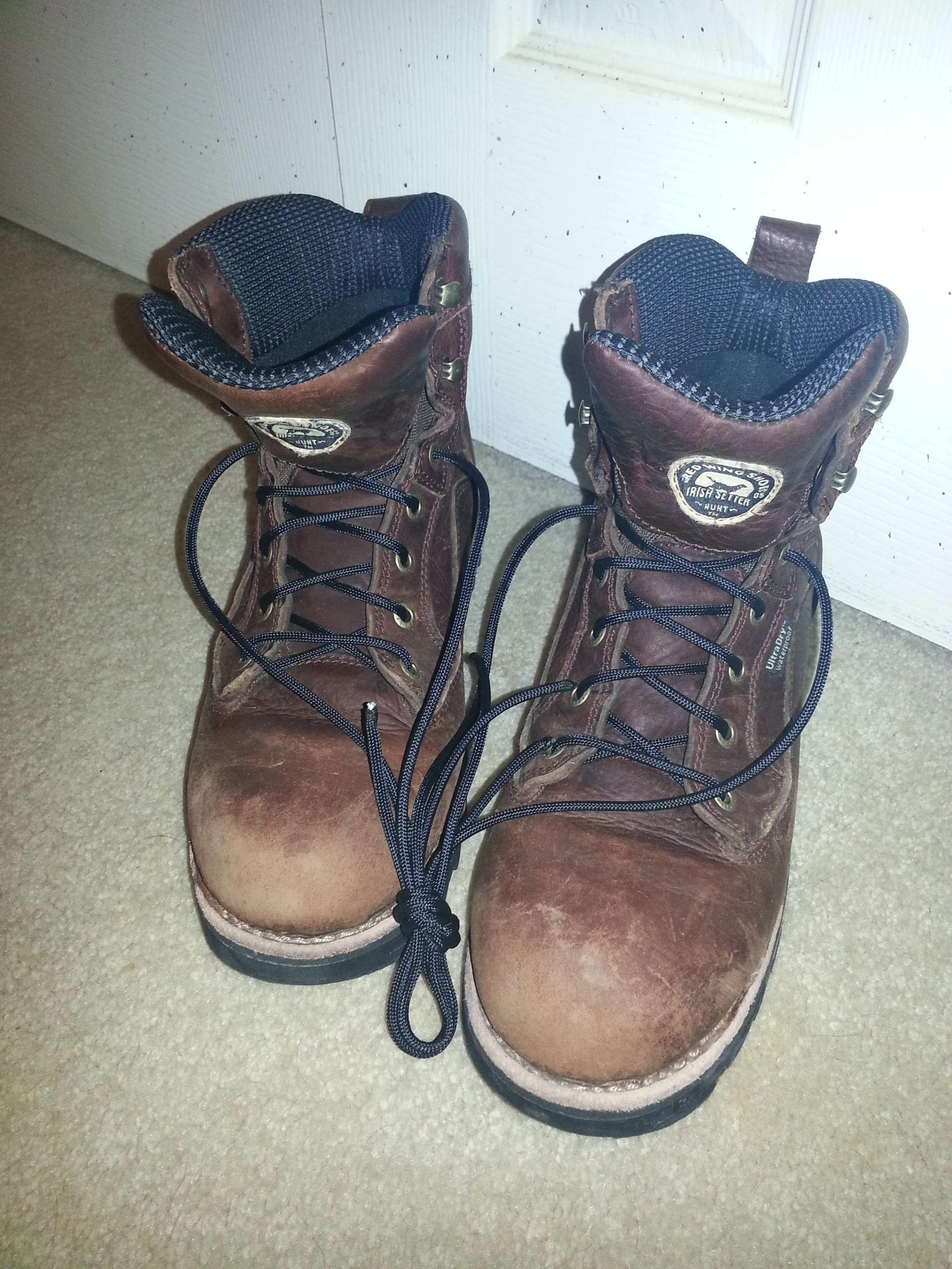Hiking boots with black paracord laces
